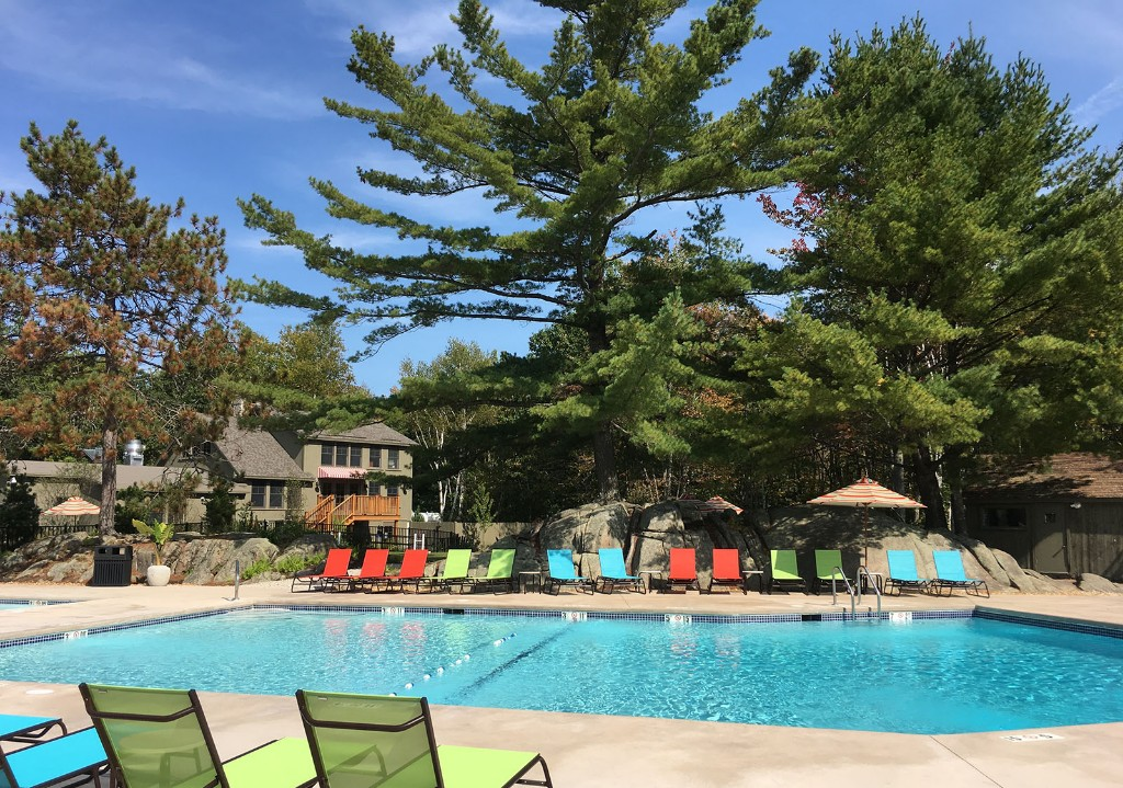 Sandy-Pines-Campground-Pool-Chairs-and-Pine